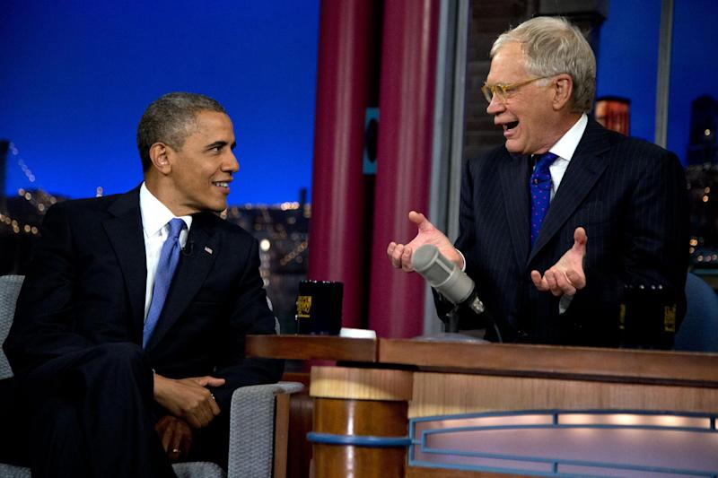 """President Barack Obama talks with David Letterman on the set of the """"Late Show With David Letterman"""" at the Ed Sullivan Theater, Tuesday, Sept. 18, 2012, in New York.  (AP Photo/Carolyn Kaster)"""