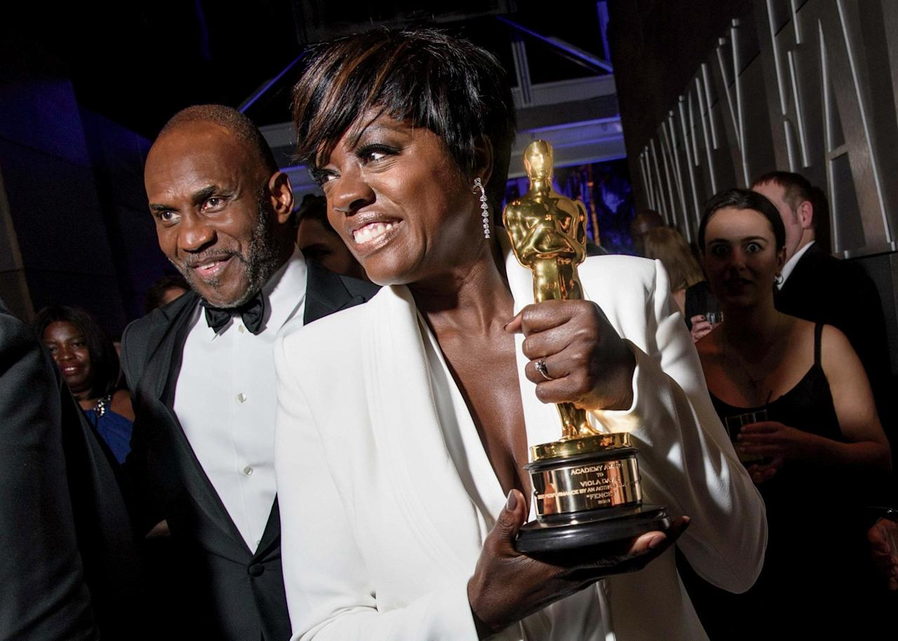 Julius Tennon and Viola Davis with her Oscar win in 2017.