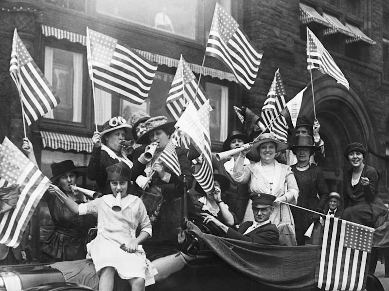 American suffragists celebrate their victory following the passing of the 19th Amendment in August 1920. (Getty Images)