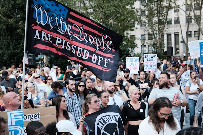 People march against COVID-19 mandates at a rally Sept. 13 in New York City.