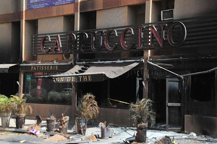 The Cappuccino Cafe located near the Splendid Hotel, both destroyed earlier by Al-Qaeda in the Islamic Maghreb , in Ouagadougou, on January 21, 2016 (AFP Photo/AHMED OUOBA)