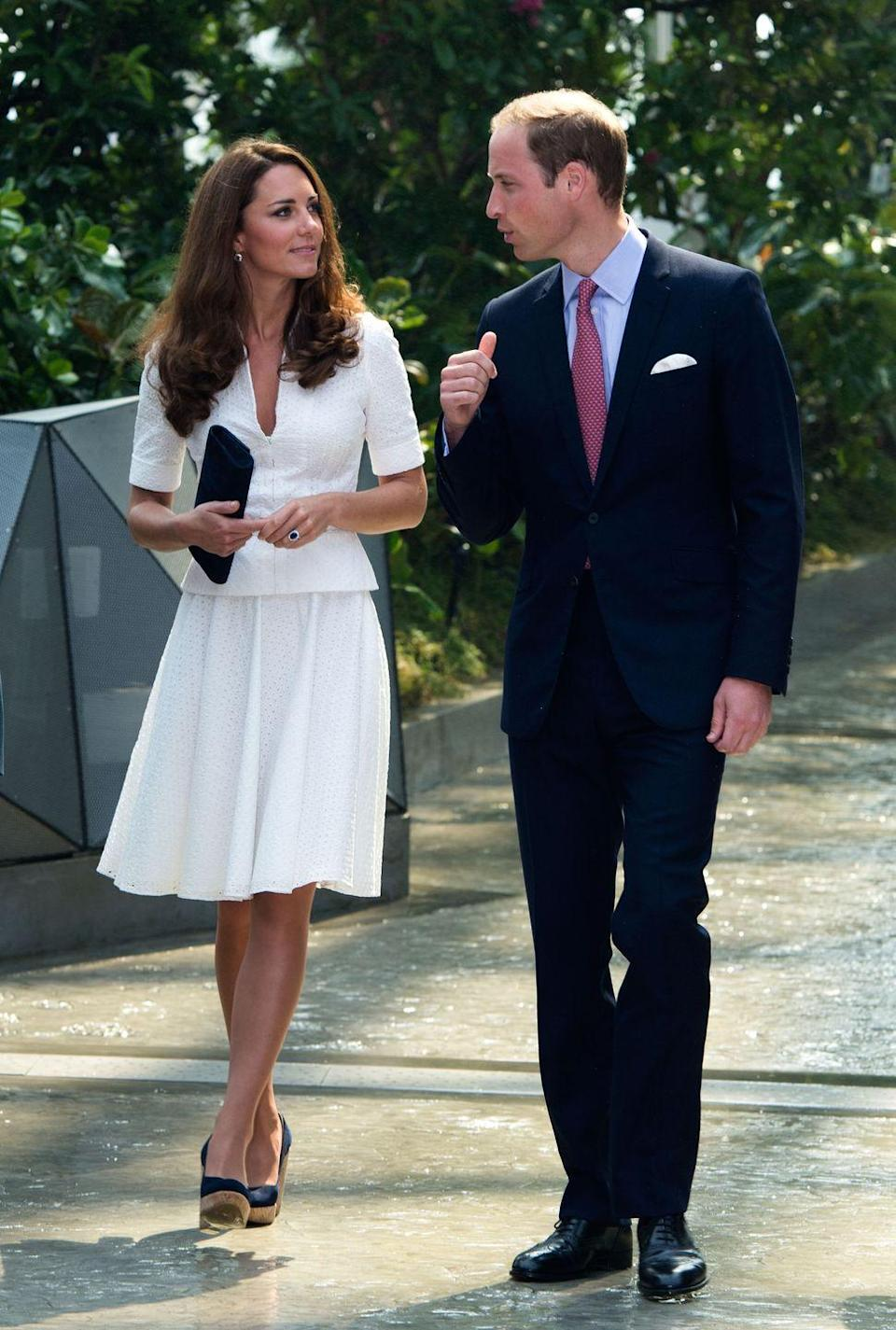 <p>Kate first wore this white broderie anglaise dress by Alexander McQueen while in Singapore for a Diamond Jubilee tour. Here, she and Will walked through the Gardens by the Bay. </p>