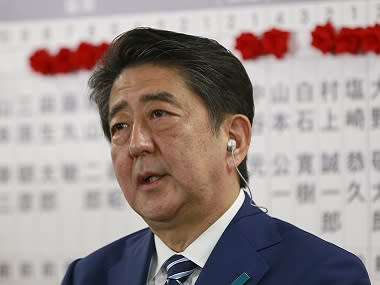 Prime Minister Shinzo Abe visits flood-hit zone in Japan's Okayama; search and rescue operations underway