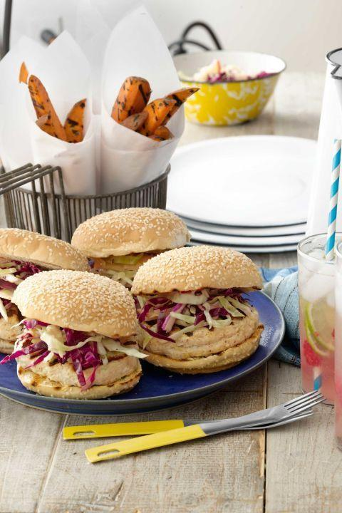 """<p>Compared with a typical cheeseburger slathered in mayo, this miso-glazed chicken version—topped with flavorful slaw—saves you 109 calories, 24 grams of fat, and 34 milligrams of cholesterol per serving.</p><p><strong><a href=""""https://www.countryliving.com/food-drinks/recipes/a3885/miso-glaze-chicken-burgers-cabbage-apple-slaw-recipe-clv0612/"""" rel=""""nofollow noopener"""" target=""""_blank"""" data-ylk=""""slk:Get the recipe"""" class=""""link rapid-noclick-resp"""">Get the recipe</a>.</strong></p>"""