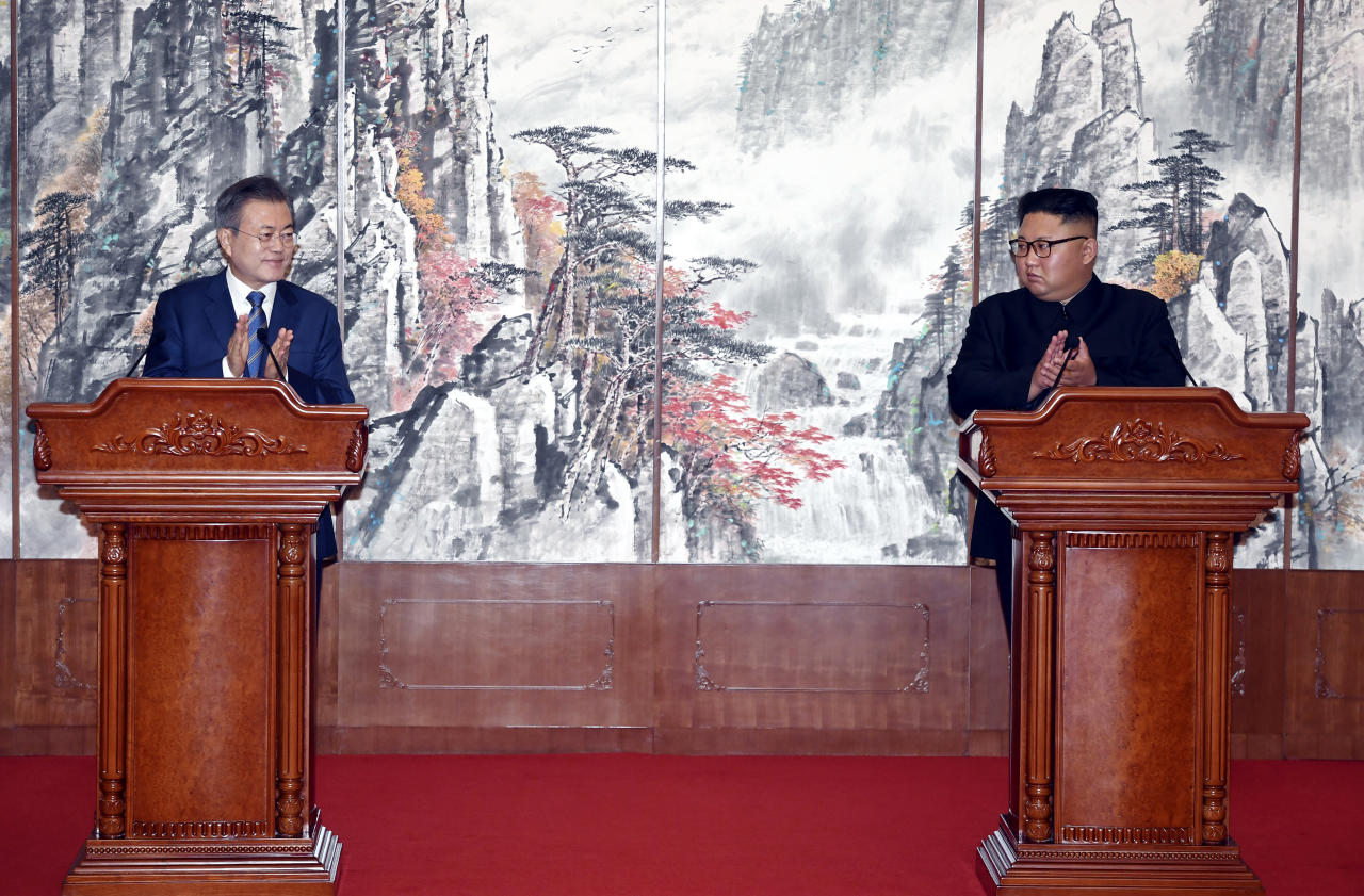 South Korean President Moon Jae-in, left, and North Korean leader Kim Jong Un clap hands during a joint press conference at the Paekhwawon State Guesthouse in Pyongyang, North Korea, Wednesday, Sept. 19, 2018. (Pyongyang Press Corps Pool via AP)