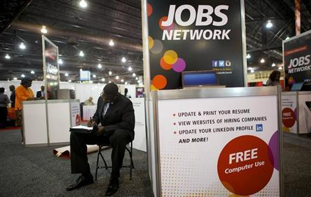 A job-seeker completes an application at a career fair held by civil rights organization National Urban League as part of its annual conference, in Philadelphia July 25, 2013. REUTERS/Mark Makela