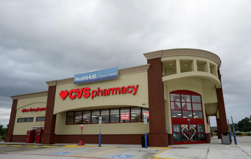 """FILE - In this May 30, 2019, file photo, a CVS store with the new HealthHUB is shown in Spring, Texas.Pharmacy chains, including CVS, are fighting claims that they're to blame for the opioid crisis in two Ohio counties. The Monday, Jan. 6, 2020, filings asked U.S. district Court Judge Dan Polster to find in the pharmacies' favor and reject claims brought by Summit and Cuyahoga counties, home to Akron and Cleveland respectively, that argue that chains such as CVS, Rite Aid and Walgreens contributed to the problem by filling an """"excessive volume"""" of opioid prescriptions.  (AP Photo/David J. Phillip, File)"""