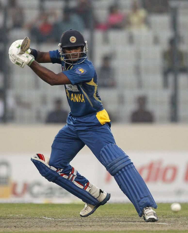 Sri Lanka's Lahiru Thirimanne plays a ball against Bangladesh during their third one day international (ODI) cricket match of the series in Dhaka February 22, 2014. REUTERS/Andrew Biraj (BANGLADESH - Tags: SPORT CRICKET)