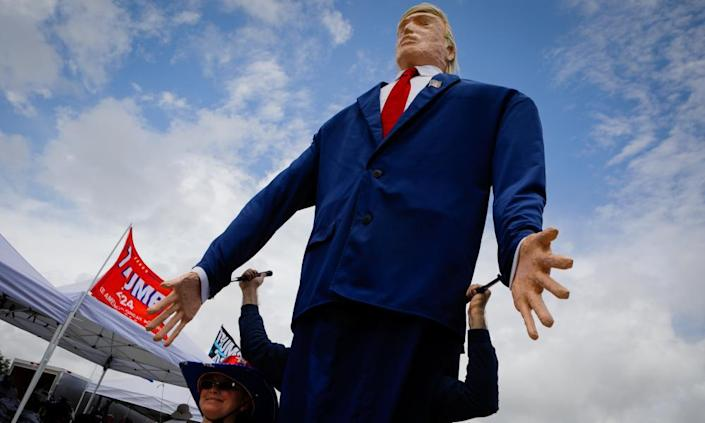 A giant Donald Trump loomed over supporters at the rally, which was co-sponsored by the Republican Party of Florida.