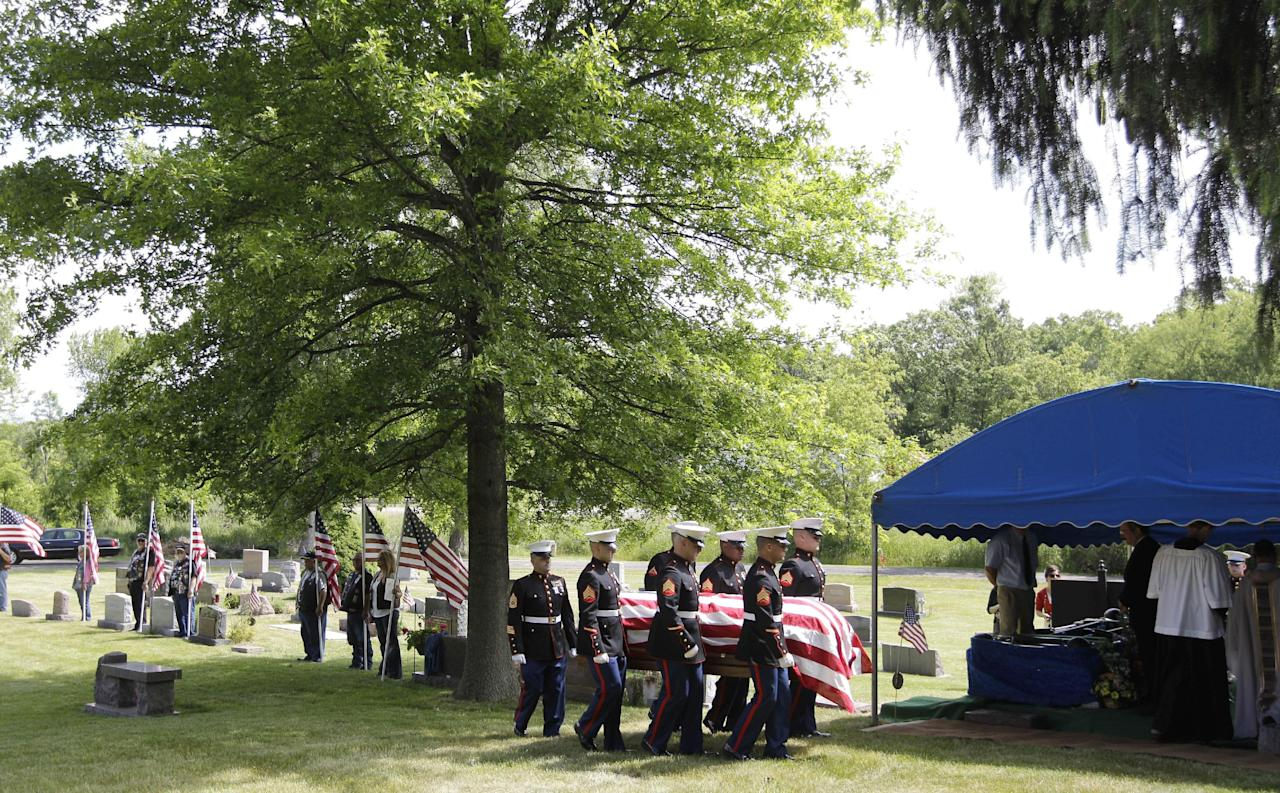 Marine pallbearers carry the casket of Marine Pfc. John Albert Donovan after a funeral service at the Old St. Patrick Catholic Church in Northfield Township, Mich., Friday, June 8, 2012. Nearly seven decades after he went missing following a World War II bomber crash, Donovan was laid to rest in a cemetery across the street from the church. His remains were identified this year. (AP Photo/Carlos Osorio)