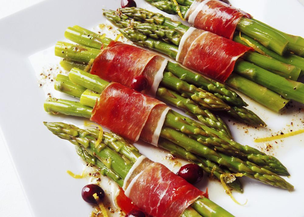 "<p>Another aphrodisiac member of the food family, asparagus is a definite inclusion in your Valentine's feast. How about <a rel=""nofollow"" href=""http://www.greatbritishchefs.com/recipes/asparagus-recipe-truffle-duck-egg-hollandaise"">this decadent recipe</a> from chef Mark Jordan to really impress? [Photo: Rex] </p>"