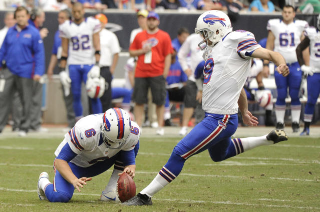 Buffalo Bills' Shawn Powell (6) holds the ball as Rian Lindell (9) kicks a field goal against the Houston Texans in the third quarter of an NFL football game on Sunday, Nov. 4, 2012, in Houston. (AP Photo/Dave Einsel)