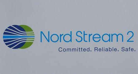 FILE PHOTO: The logo of the Nord Stream-2 gas pipeline project is seen on a board at the SPIEF 2017 in St. Petersburg, Russia