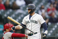 Seattle Mariners' Ty France walks away from the plate after striking out against the Los Angeles Angels during the third inning of a baseball game Saturday, May 1, 2021, in Seattle. (AP Photo/Elaine Thompson)