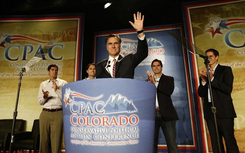 Republican presidential candidate, former Massachusetts Gov. Mitt Romney speaks at a Colorado Conservative Political Action Committee (CPAC) meeting in Denver, Thursday, Oct. 4, 2012. At rear are sons Matt, Craig, Tagg, Josh Romney. (AP Photo/Charles Dharapak)