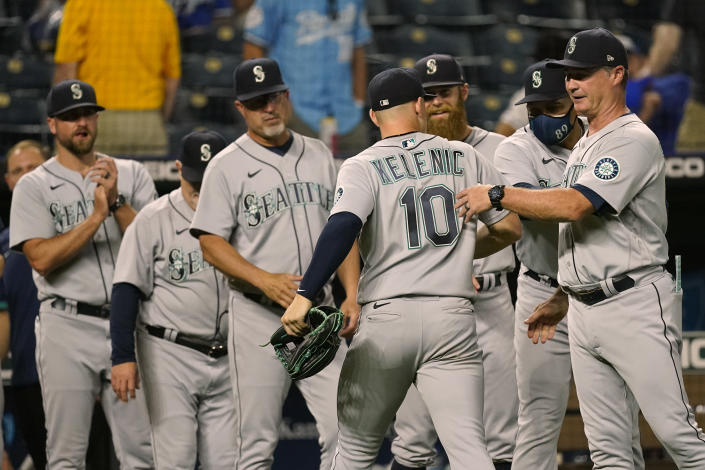 Seattle Mariners' Jarred Kelenic (10) celebrates with teammates after their baseball game against the Kansas City Royals Friday, Sept. 17, 2021, in Kansas City, Mo. Seattle won 6-2. (AP Photo/Charlie Riedel)