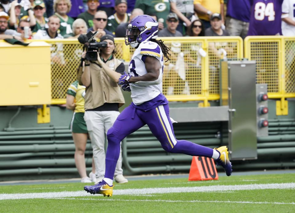 Minnesota Vikings' Dalvin Cook runs for a touchdown during the first half of an NFL football game against the Green Bay Packers Sunday, Sept. 15, 2019, in Green Bay, Wis. (AP Photo/Mike Roemer)