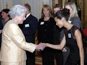 <p>British actress Thandie Newton kept things elegant and simple in a little black dress with sheer paneling when meeting Queen Elizabeth at a palace reception. She also seems to have the whole curtsy thing down pat.</p>
