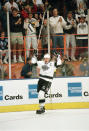 FILE - Wayne Gretzky and fans celebrate after he scored his NHL career record-setting 802nd goal against the Vancouver Canucks at the Forum in Inglewood, Calif., in this March 23, 1994, file photo. Alex Ovechkin starts a new five-year contract ready to chase Wayne Gretzky's career goals record that long seemed unbreakable. The Washington Capitals captain has 730 goals and needs 165 to pass Gretzky. (AP Photo/Eric Draper, File)