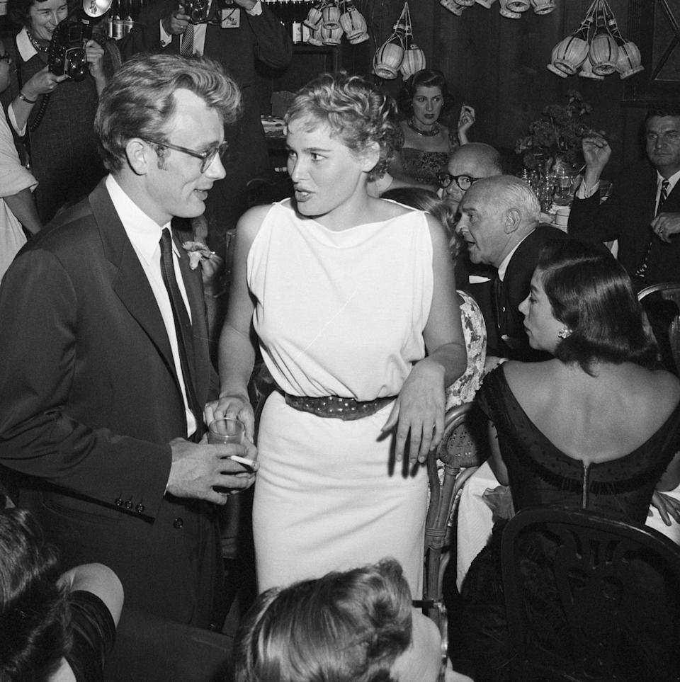 <p>Dean began seeing film newcomer Ursula Andress in 1955. Here, Dean and the Swiss-born actress arrive at a Hollywood party together.</p>