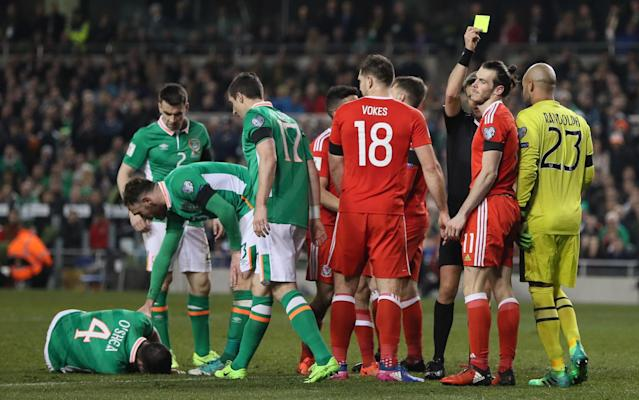 <span>Gareth Bale was shown a yellow card for his late tackle on John O'Shea</span> <span>Credit: Rxe Features </span>