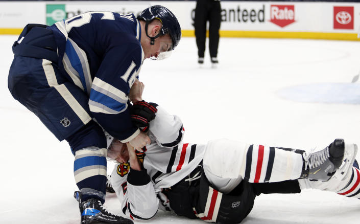 Columbus Blue Jackets forward Max Domi, left, fights with Chicago Blackhawks defenseman Connor Murphy during the second period of an NHL hockey game in Columbus, Ohio, Monday, April 12, 2021. (AP Photo/Paul Vernon)