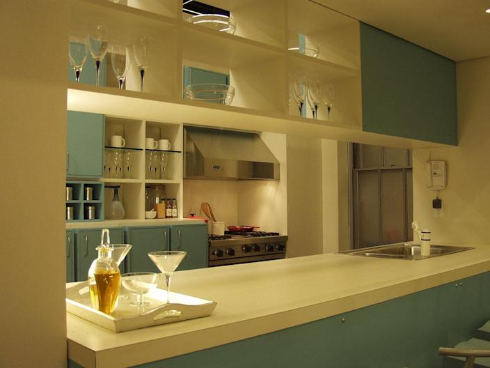 Samantha didn't do a lot of cooking, but she had a very cool blue kitchen in her Meatpacking District apartment.