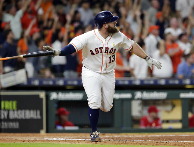 Houston Astros designated hitter Tyler White (13) flips his bat as he watches his two-run RBI double, driving in the go-ahead runs against the Los Angeles Angels during the eighth inning of a baseball game, Saturday, Sep. 1, 2018, in Houston. (AP Photo/Michael Wyke)