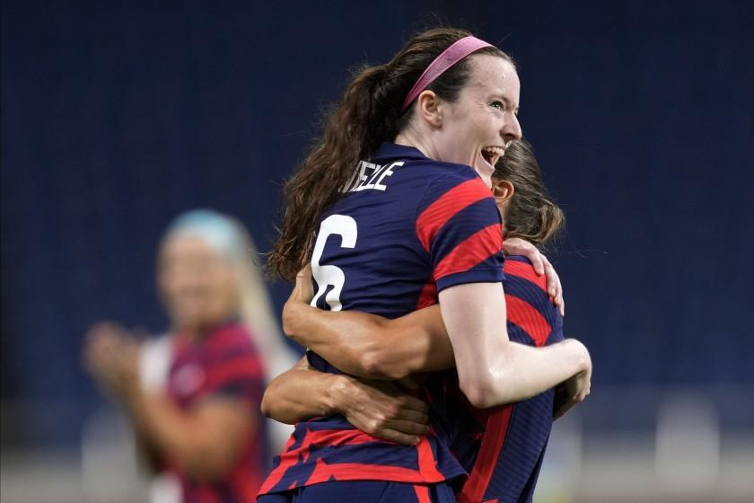 United States' Rose Lavelle, left, celebrates after scoring a goal during a women's soccer match against New Zealand at the 2020 Summer Olympics, Saturday, July 24, 2021, in Saitama, Japan. (AP Photo/Martin Mejia)