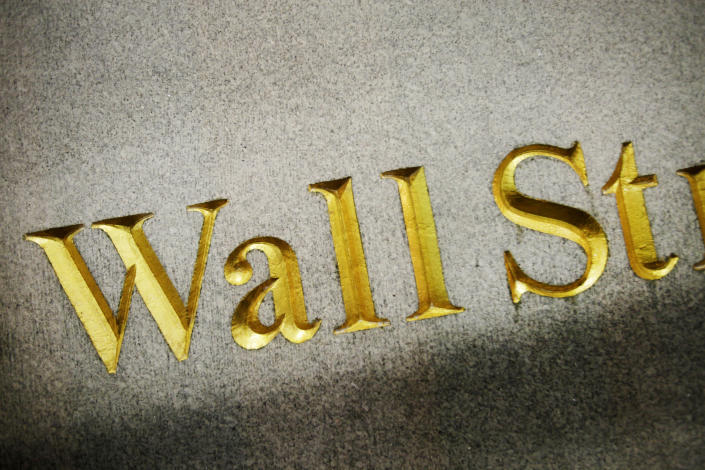 FILE - This Oct. 8, 2014, file photo shows a Wall Street address carved in the side of a building, in New York. The banking system is not as risk of failing as banks have plenty of capital on hand to handle this crisis due to the new coronavirus, economists say. (AP Photo/Mark Lennihan, File)