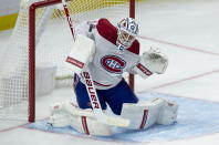 Montreal Canadiens goaltender Jake Allen makes a save against the Ottawa Senators during the second period of an NHL hockey game Sunday, Feb. 21, 2021, in Ottawa, Ontario. (Adrian Wyld/The Canadian Press via AP)