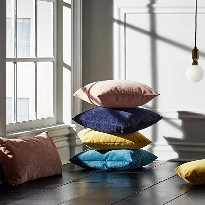 """<p>Brighten up your sofa with these soft <a href=""""https://www.popsugar.com/buy/Rivet-Velvet-Texture-Striated-Pillows-584897?p_name=Rivet%20Velvet%20Texture%20Striated%20Pillows&retailer=amazon.com&pid=584897&price=39&evar1=casa%3Aus&evar9=45784601&evar98=https%3A%2F%2Fwww.popsugar.com%2Fhome%2Fphoto-gallery%2F45784601%2Fimage%2F45784626%2FRivet-Velvet-Texture-Striated-Pillow&list1=shopping%2Camazon%2Cproducts%20under%20%2450%2Cdecor%20inspiration%2Caffordable%20shopping%2Chome%20shopping&prop13=api&pdata=1"""" class=""""link rapid-noclick-resp"""" rel=""""nofollow noopener"""" target=""""_blank"""" data-ylk=""""slk:Rivet Velvet Texture Striated Pillows"""">Rivet Velvet Texture Striated Pillows</a> ($39).</p>"""