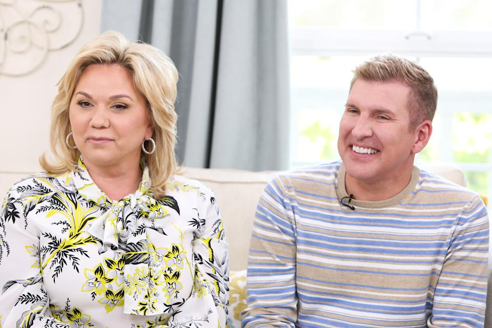 """UNIVERSAL CITY, CA - JUNE 18:  Reality TV Personalities Julie Chrisley (L) and Todd Chrisley (R) visit Hallmark's """"Home & Family"""" at Universal Studios Hollywood on June 18, 2018 in Universal City, California.  (Photo by Paul Archuleta/Getty Images)"""