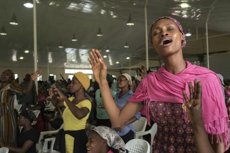 """People pray at a """"singles summit"""" held at the Mountain of Fire and Miracles Ministries' its vast Prayer City complex, off the Lagos to Ibadan expressway"""