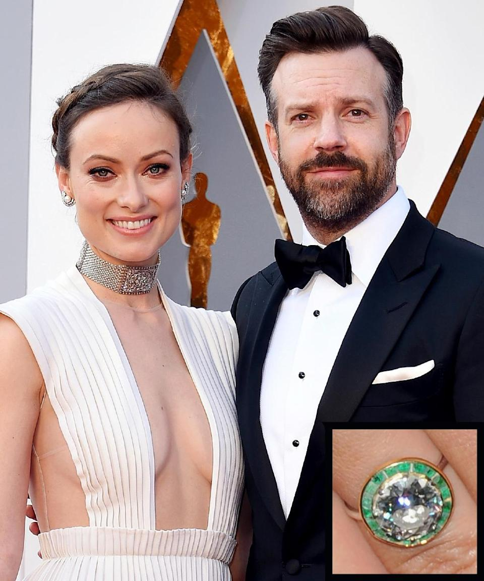 """<p>Actor Jason Sudeikis proposed to Olivia Wilde in January 2013 with diamond ring circled with emeralds. The actress has said that Sudeikis picked that particular <a rel=""""nofollow noopener"""" href=""""http://www.instyle.com/news/olivia-wildes-engagement-ring-big-photo-big-rock"""" target=""""_blank"""" data-ylk=""""slk:ring"""" class=""""link rapid-noclick-resp"""">ring</a> because the color reminded him of her eyes.</p>"""