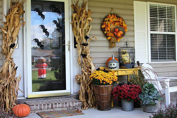 """<p>Some faux creatures - including bats, crows, and an owl - make this front door feel very alive.</p><p><strong>Get the tutorial at <a rel=""""nofollow"""" href=""""https://www.houseofhawthornes.com/transitioning-the-porch-from-fall-to-halloween/"""">House of Hawthornes</a>.</strong></p><p><a rel=""""nofollow"""" href=""""https://www.etsy.com/listing/399417219/bats-black-felt-mixed-size-bat-packs"""">SHOP FELT BATS</a><br></p>"""