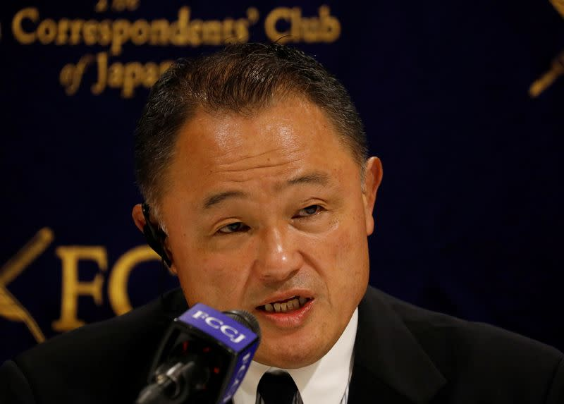 Japanese Olympic Committee President Yasuhiro Yamashita attends a news conference in Tokyo