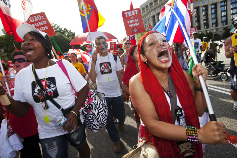 Geojina Gutierrez, right, of Mexico City, walks in the AIDS March in Washington, on Sunday, July 22, 2012. (AP Photo/Jacquelyn Martin)