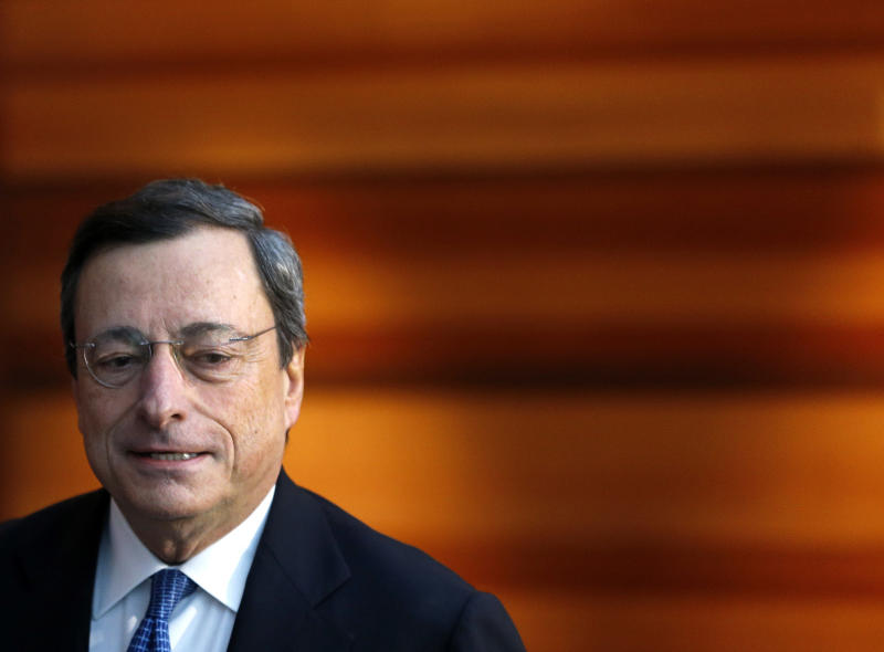President of European Central Bank, ECB, Mario Draghi arrives for a news conference in Frankfurt, Germany, Thursday, Nov. 8, 2012, following a meeting of the ECB governing council. The bank held off cutting interest rates Thursday even though the economy of the 17 countries that use the euro is in desperate need of a lift. It left its key interest rate unchanged at a record low 0.75 percent at its monthly rate-setting meeting in Frankfurt. (AP Photo/Michael Probst)