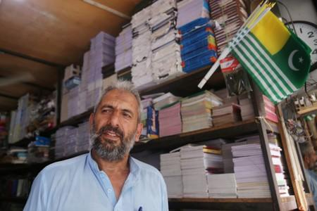 Ali Mohammad, who is a former militant and works at a stationary shop speaks with Reuters in Muzaffarabad