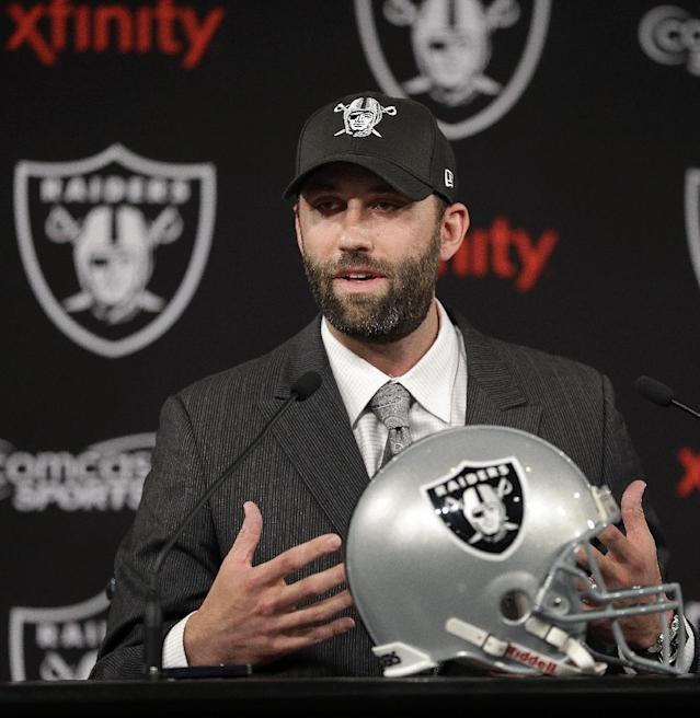 Oakland Raiders quarterback Matt Schaub gestures during a news conference Friday, March 21, 2014, at the NFL football team's practice facility in Alameda, Calif. Schaub and the Raiders are both hoping to put the mistakes of 2013 in the past. The Raiders acquired Schaub from Houston for an undisclosed draft pick, giving the quarterback a second chance after he lost his starting job with the Texans last season. (AP Photo/Ben Margot)