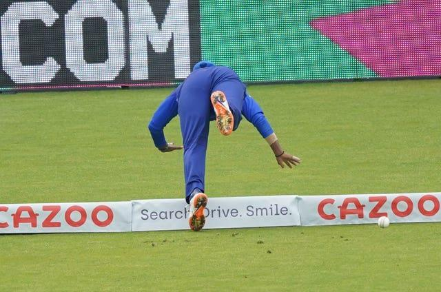Deepti Sharma of the London Spirit dives to prevent a boundary during The Hundred match against the Oval Invincibles at Lord's