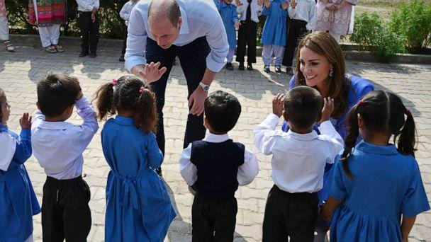 PHOTO: Britain's Prince William, Duke of Cambridge, and his wife Catherine, Duchess of Cambridge, meet with school children during their visit to a government-run school in Islamabad, Oct. 15, 2019. (Aamir Qureshi/AFP via Getty Images)