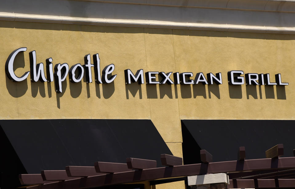 A Chipotle Mexican Grill restaurant is seen at the Simi Valley Town Center, Tuesday, April 21, 2020, in Simi Valley, Calif. Federal prosecutors say Chipotle Mexican Grill has agreed to pay a record $25 million fine to resolve criminal charges that it served tainted food that sickened more than 1,100 people in the U.S. from 2015 to 2018. The fast food company was charged Tuesday in Los Angeles federal court with two counts of violating the Food, Drug, and Cosmetic Act by serving adulterated food. The charges stem from outbreaks of norovirus, which causes diarrhea, at Chipotle restaurants. The virus is easily transmitted by infected food food workers. The Newport Beach, California-based company will avoid conviction by improving its food safety. (AP Photo/Mark J. Terrill)
