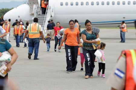 Handout photo of women and children at the Ramon Villeda international airport in San Pedro Sula after deportation from U.S.