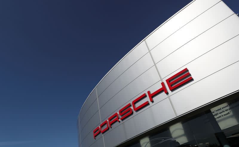 FILE PHOTO: A logo of Porsche is seen outside a Porsche car dealer, amid the coronavirus disease (COVID-19) outbreak in Brussels