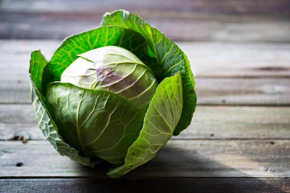 """<p>If you're buying your cabbage pre-shredded, you're messing up. Pre-cut vegetables of any kind are one of the <a href=""""https://www.thedailymeal.com/cook/15-grocery-items-you-should-stop-buying-gallery?referrer=yahoo&category=beauty_food&include_utm=1&utm_medium=referral&utm_source=yahoo&utm_campaign=feed"""" rel=""""nofollow noopener"""" target=""""_blank"""" data-ylk=""""slk:grocery items you should stop buying"""" class=""""link rapid-noclick-resp"""">grocery items you should stop buying</a>. Buying cabbage whole shaves lot of cash from your grocery bill — so long as you know how to store it. Once you slice open a cabbage, the exposed end is in danger of oxidation. To protect against oxidation, simply cover the open end with a light layer of lemon juice. It won't last forever, but this tip will help maintain the integrity of your cabbage.</p>"""