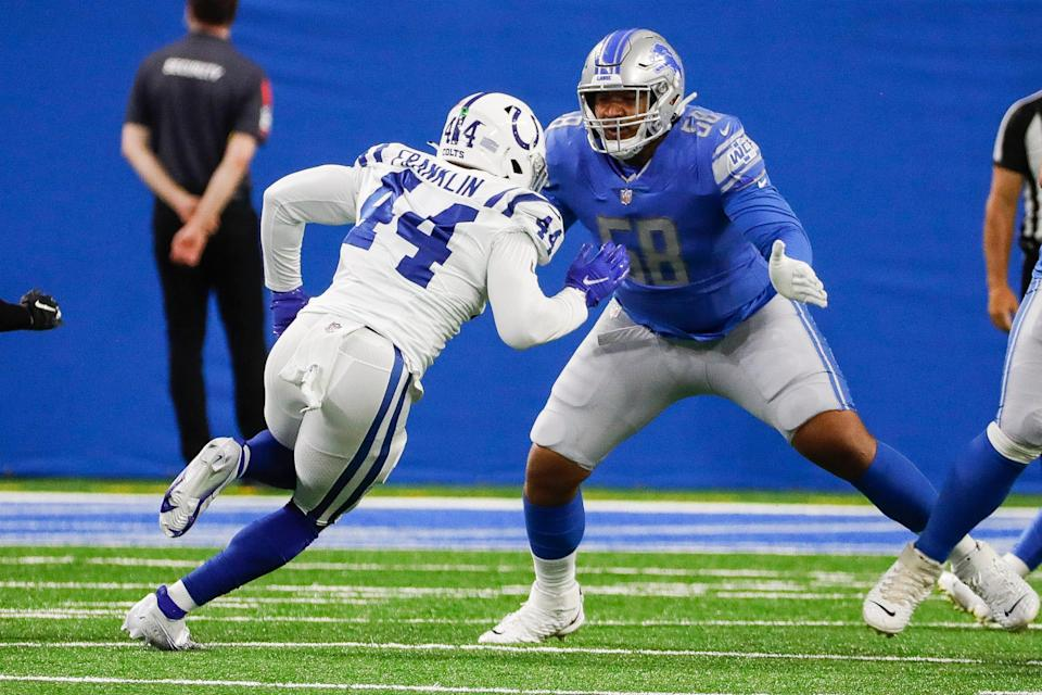 Detroit Lions offensive tackle Penei Sewell (58) plays against Indianapolis Colts linebacker Zaire Franklin (44) during the first half of a preseason game at Ford Field in Detroit, Friday, August 27, 2021.