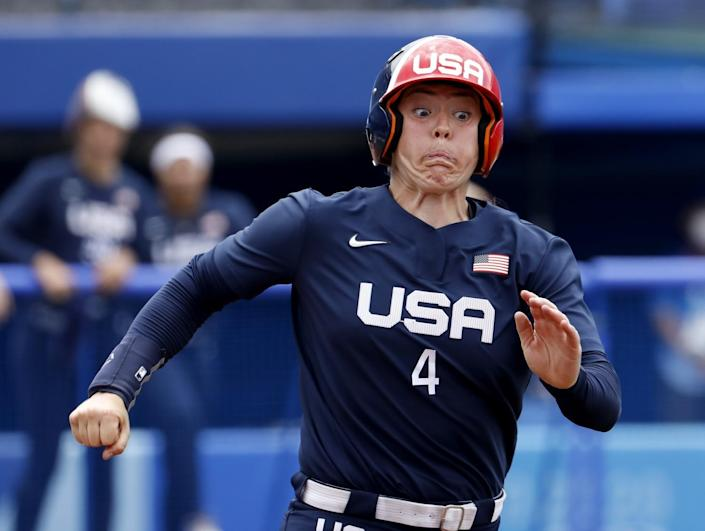 U.S. player Amanda Chidester strains as she runs to first base against Japan on Monday.