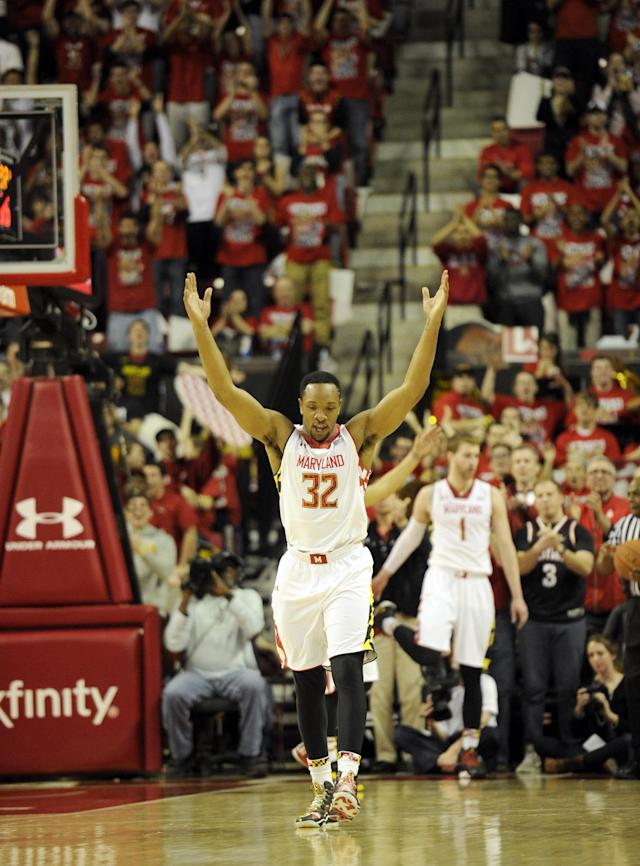 Maryland guard/forward Dez Wells (32) reacts during the second half of an NCAA college basketball game against Virginia, Sunday, March 9, 2014, in College Park, Md. Maryland won 75-69 in overtime. (AP Photo/Nick Wass)